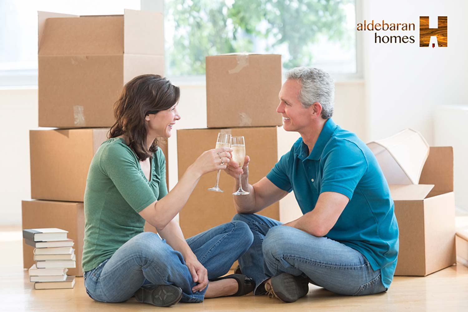 2 People Celebrating Unpacking After Moving Into An Aldebaran Home